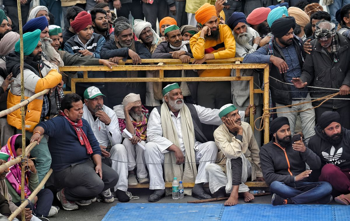 New Delhi, Jan 18 (ANI): Farmers watching womens friendly Kabaddi match during an ongoing protest against the new farm laws, at the Delhi-Ghazipur border in New Delhi on Monday.
