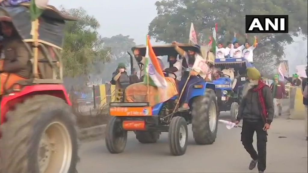 Tractor Rally Live Updates: Protesting farmers break police barricade at Tikri border