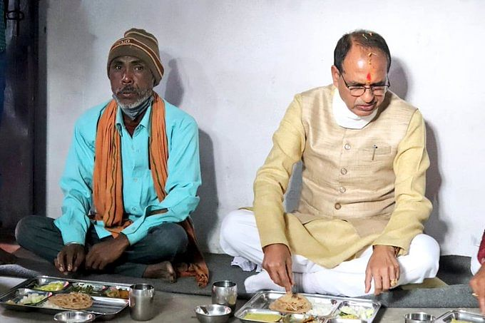 Madhya Pradesh: Chief minister Shivraj Singh Chouhan dines with tribal man in Satna