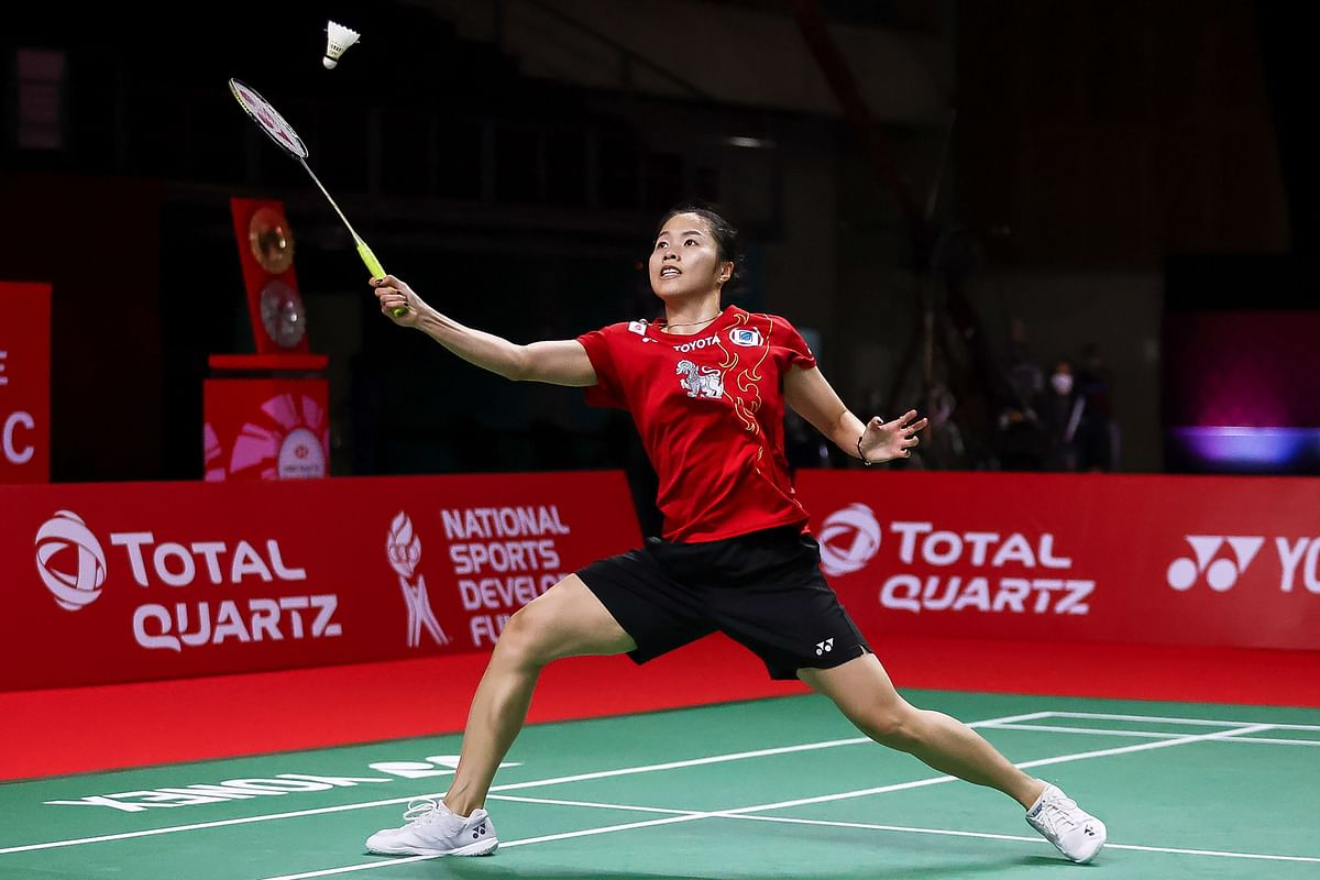 Thailand's Ratchanok Inthanon hitting a shot against India's PV Sindhu during their women's singles match at the World Tour Finals badminton tournament in Bangkok on Thursday