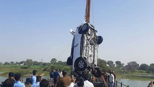 A crane fishes out ill-fated car
