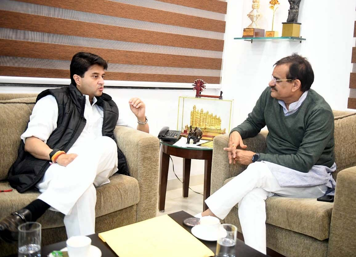 Jyotiraditya Scindia at a meeting with BJP state chief VD Sharma on Thursday.