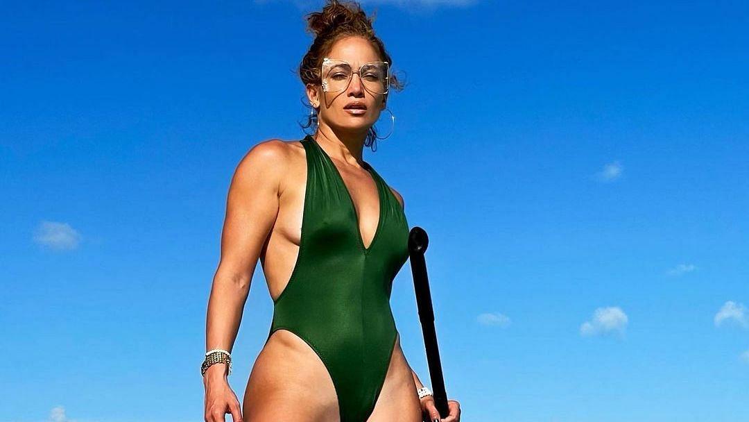 Jennifer Lopez turns up the heat in a skimpy green monokini