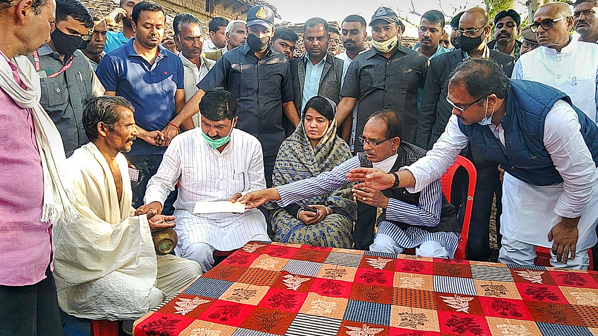 Madhya Pradesh Chief Minister Shivraj Singh Chouhan pays his condolence to the family members of bus accident victims