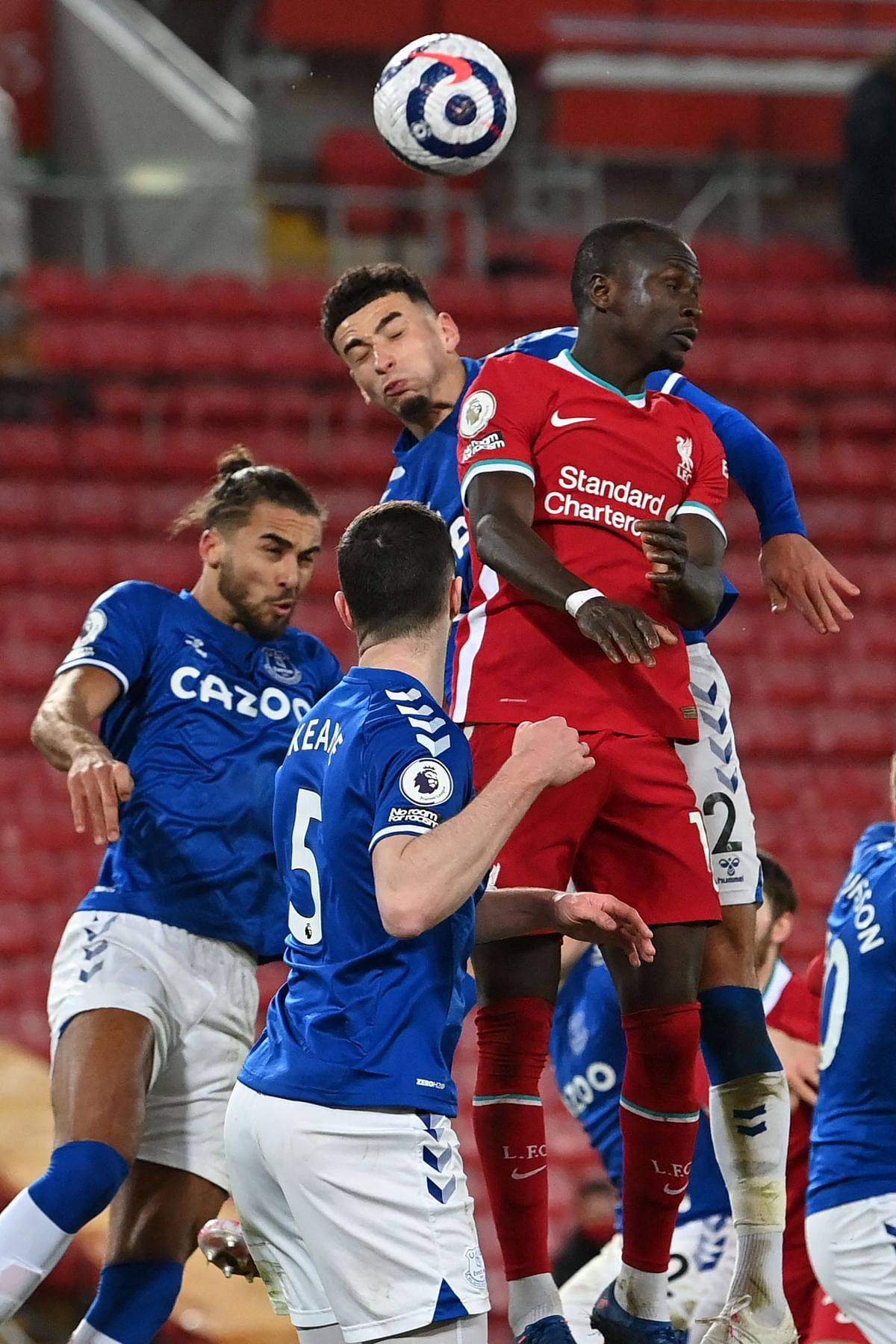 Liverpool's Senegalese striker Sadio Mane (R) vies with Everton's English striker Dominic Calvert-Lewin (L) and Everton's English midfielder Ben Godfrey (C) during their Premire League on Saturday.