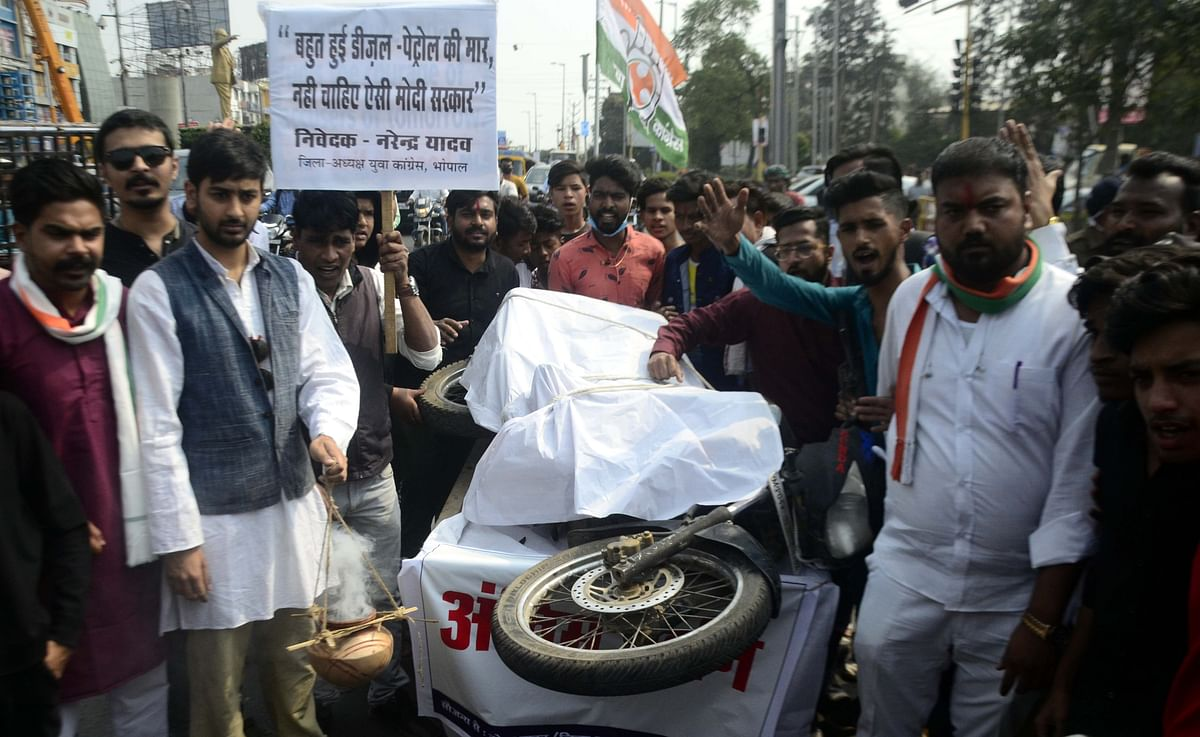 Youth Congress members protest against the hike in petrol and diesel prices in Bhopal on Monday.