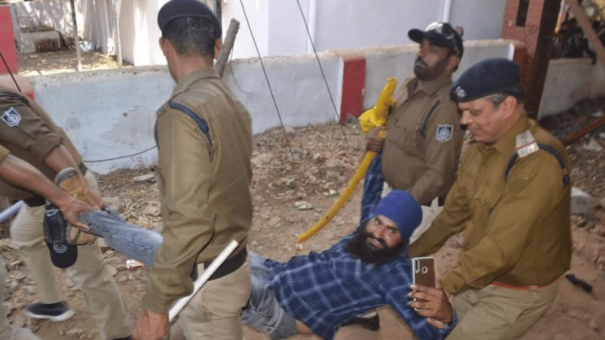 The 'selfie of the century' award goes to a hilarious viral arrest at the farmers' protest