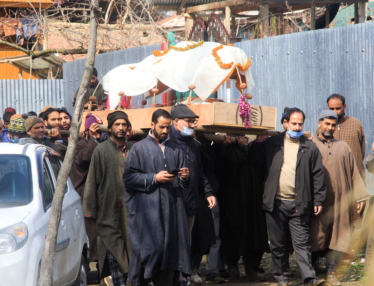 Muslims carry the body of Kashmiri pandit woman in Kunzer Village of Jammu and Kashmir.