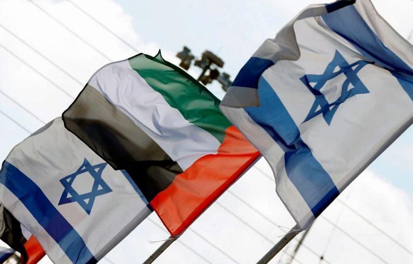 Israeli and United Arab Emirates flags line a road in the Israeli coastal city of Netanya, on Aug 16, 2020