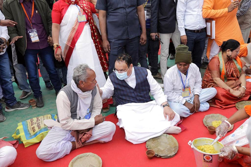 BJP national president JP Nadda having lunch with farmers during Krishok Surokha Saha-Bhoj programme in Malda, Bengal, on Saturday.