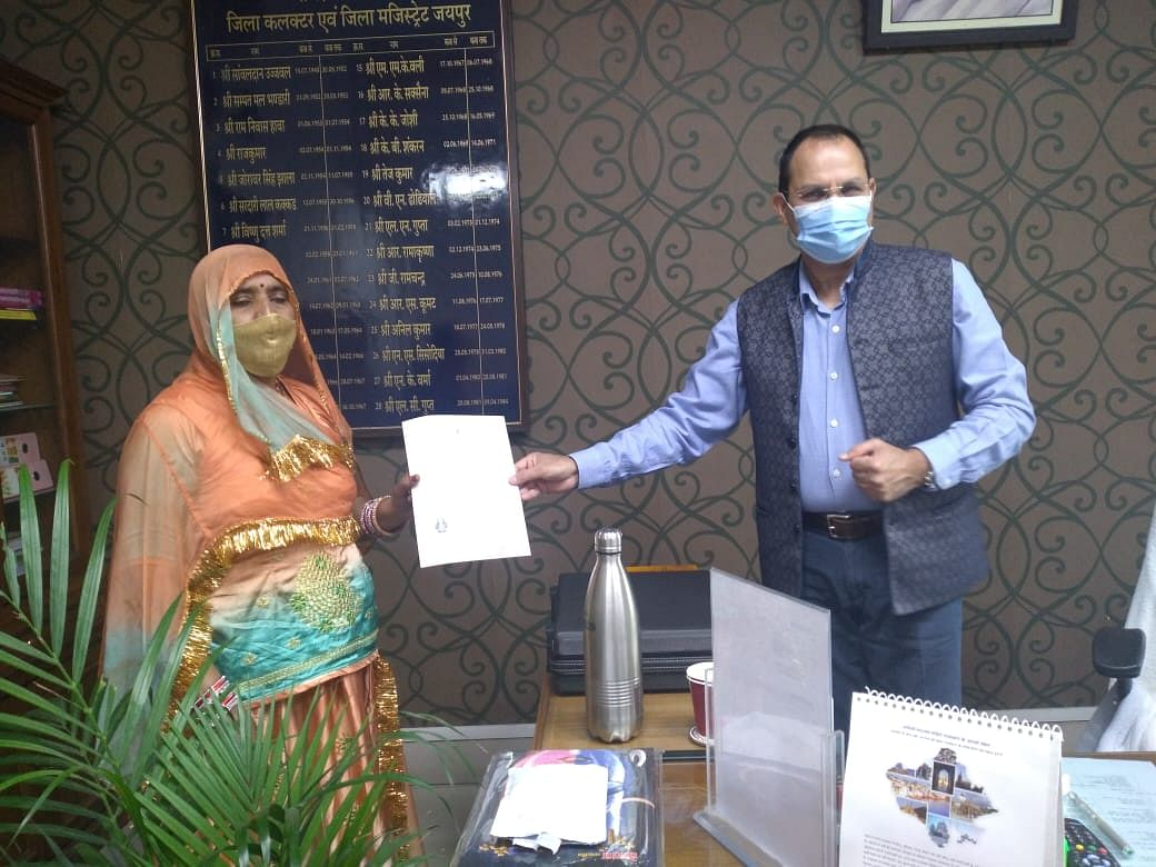 Jaipur district collector Antar Singh Nehra grants Indian citizenship to Pakistani Hindu refugees in Jaipur on Friday.