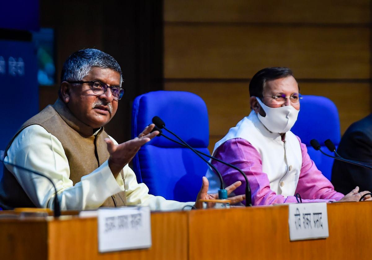 Union Ministers Ravi Shankar Prasad and Prakash Javadekar address a cabinet briefing in New Delhi, Wednesday, Feb. 24, 2021.