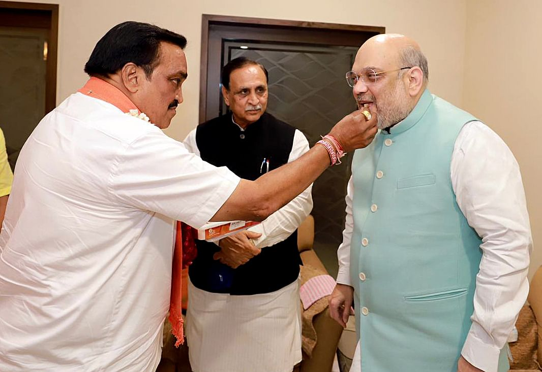 State BJP chief CR Patil being greeted with flower garland by Union Home Minister Amit Shah at his residence in presence of Chief Minister Vijay Rupani, in Ahmedabad on Tuesday.