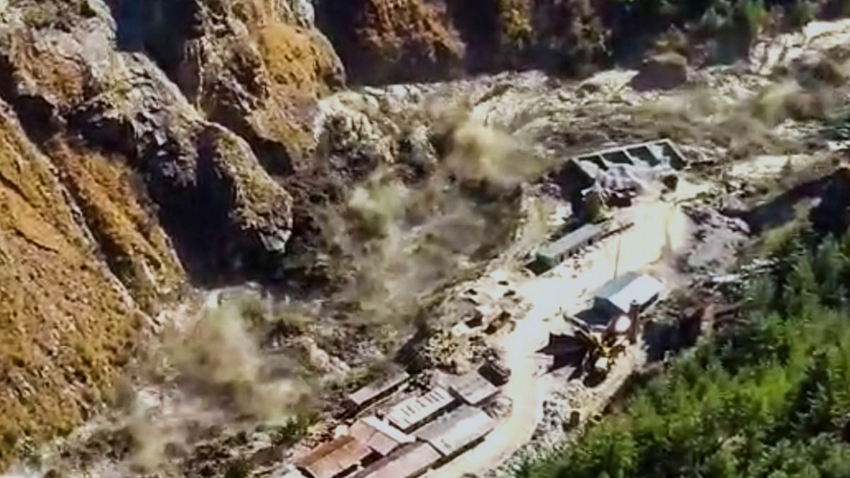 Avalanche after a glacier broke off in Joshimath in Uttarakhand?s Chamoli district causing a massive flood in the Dhauli Ganga river, Sunday, Feb. 7, 2021. More than 150 labourers working at the Rishi Ganga power project may have been directly affected