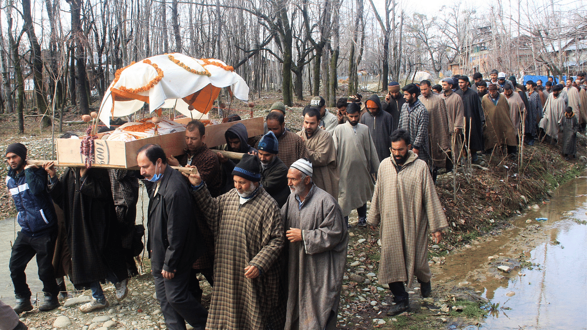 Muslims help Pandits perform last ritesof deceased Kashmiri Pandit woman at Kunzer Village of Baramulla District of Kashmir.