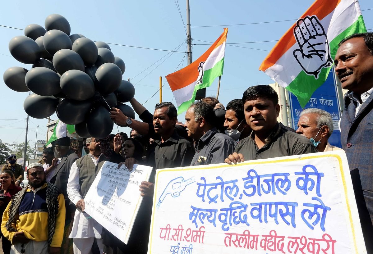 Congress Rajya Sabha MP Digvijay Singh makes an appeal to close down shops during Madhya Pradesh Bandh called as the party to protest against rising prices in diesel, petrol and gas cylinders, in Bhopal on Saturday.