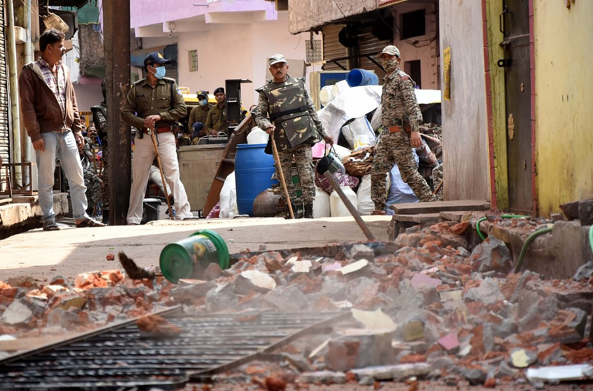 The house of a habitual offender being bulldozed in the Quazi camp area in the city on Wednesday.