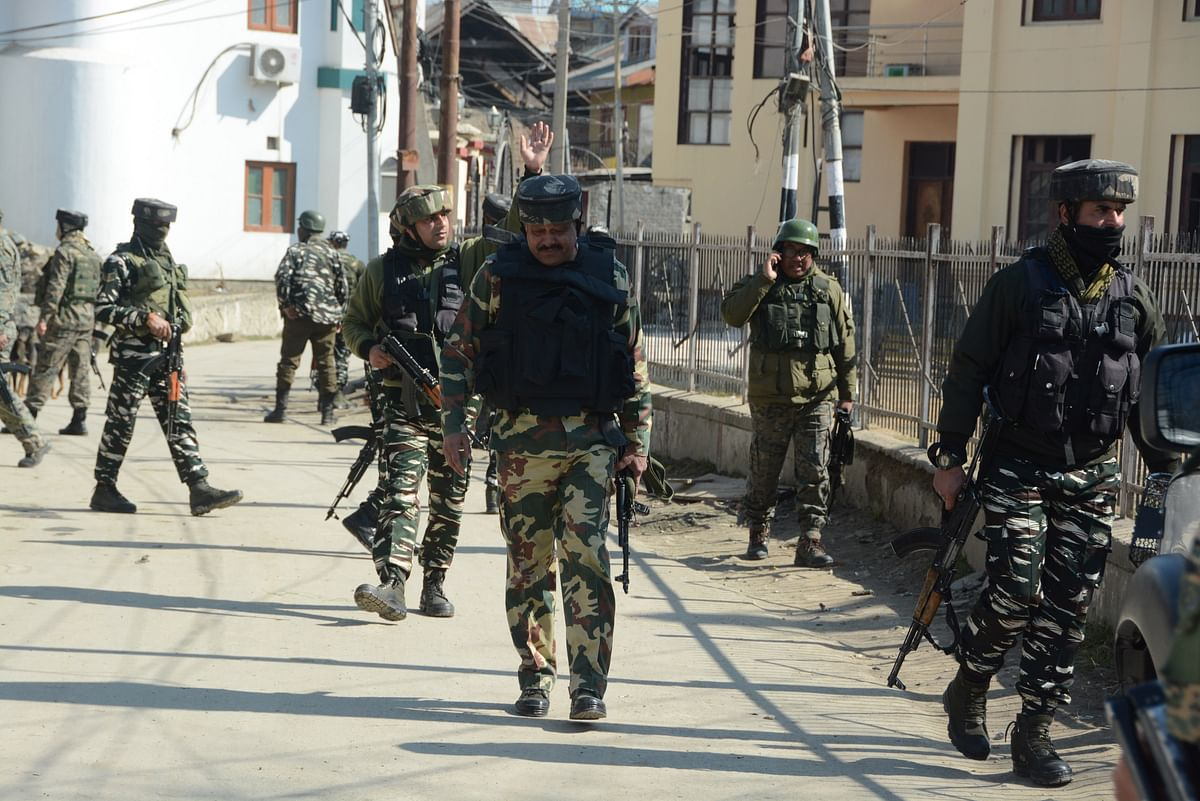 Paramilitary soldiers patrol during a search operation after suspected militants killed a policeman in a nearby village, in Beerwah area, of Budgam district in Kashmir