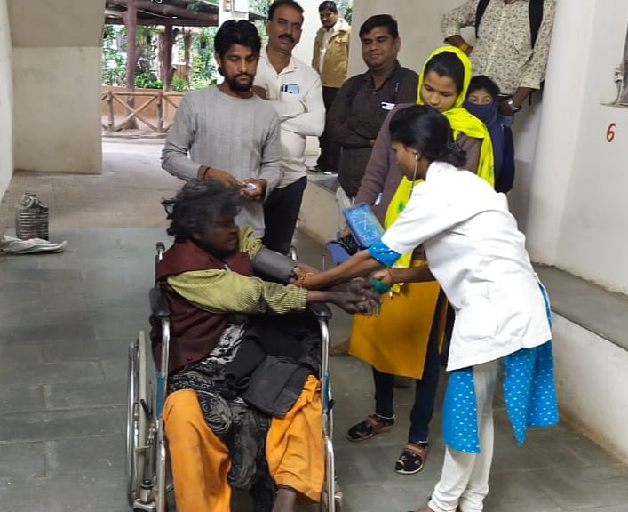 Woman being helped ay old age home in Barwani district