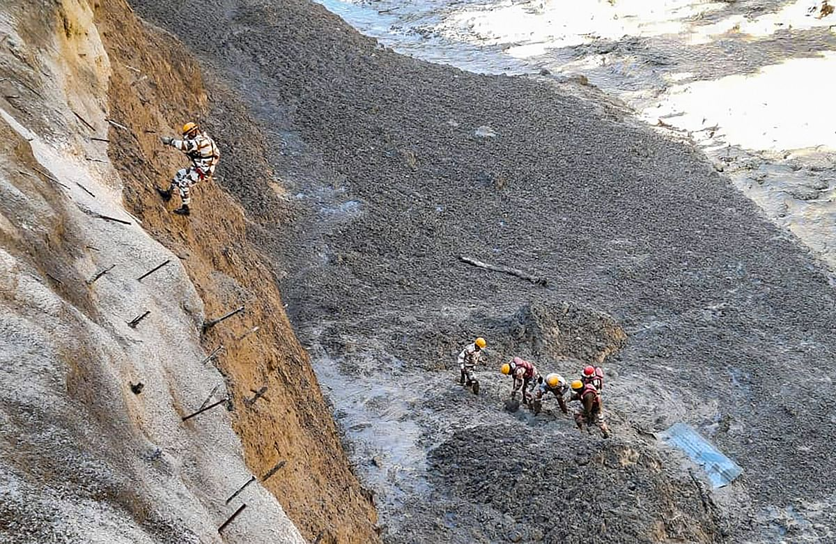 ITBP personnel dig to open Tapovan Tunnel which is completely blocked, after a glacier broke off in Joshimath in Uttarakhand?s Chamoli district causing a massive flood in the Dhauli Ganga river, Sunday, Feb. 7, 2021.