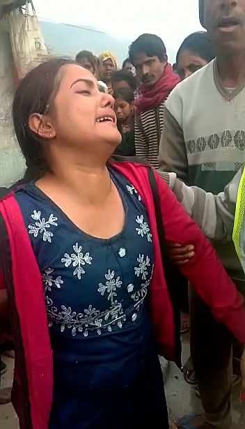 Family members mourns as a bus, carrying around 54 passengers, fell into a canal, in Sidhi on Tuesday.