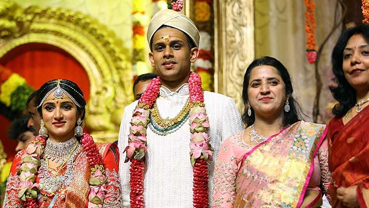State Congress chief DK Sivakumar with daughter Aishwarya and son in law Amartya Hegde gets clicked during the marriage ceremony