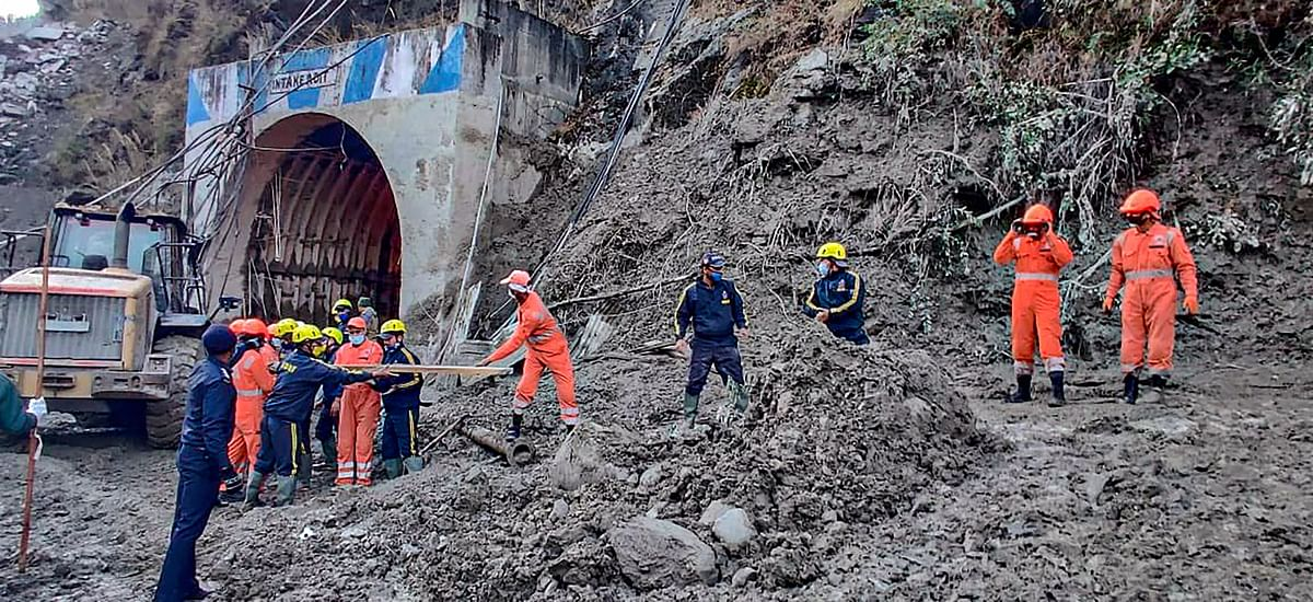 NDRF teams carry out rescue operations at tunnel, after a glacier broke off in Joshimath causing a massive flood in the Dhauli Ganga river, in Chamoli.