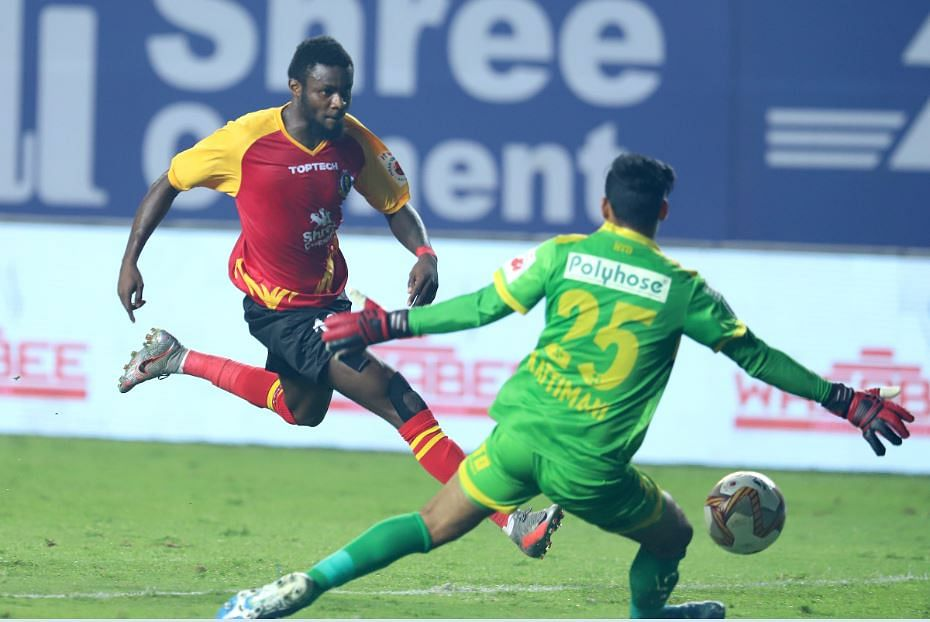 East Bengal player (L) and Hyderabad keeper in action