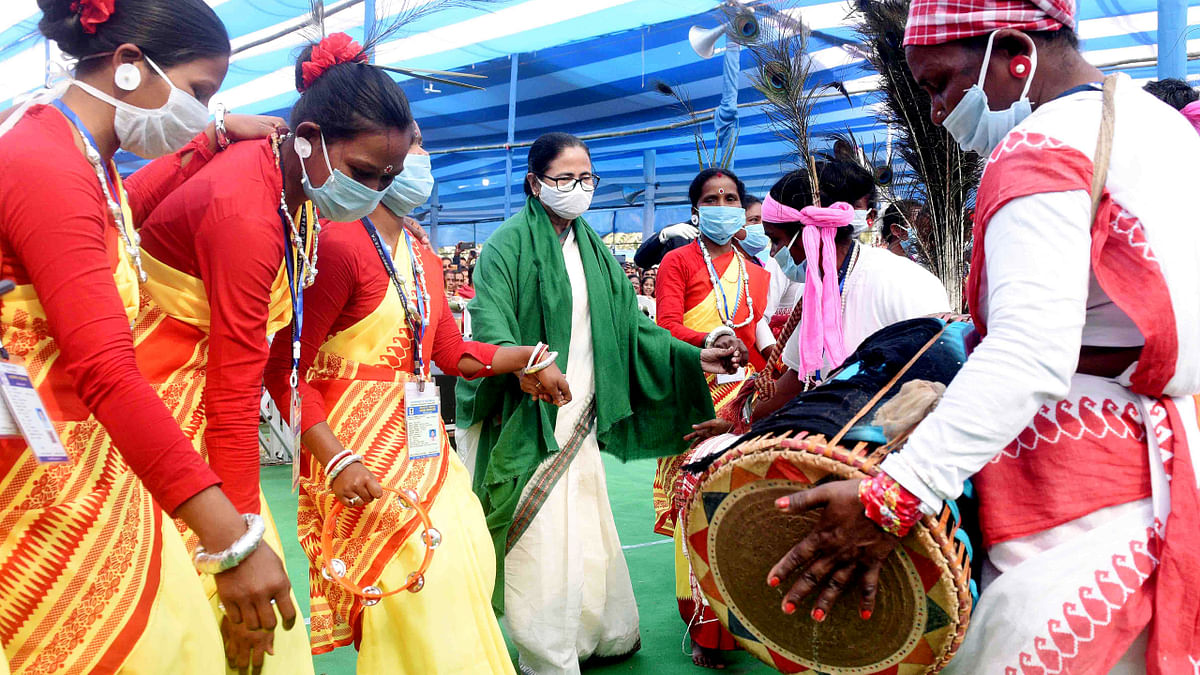 Mamata hands over concrete housing certificates to tea garden workers in north Bengal, dances with tribals