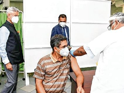 S Jaishankar watches as a medic gives a made-in-India Maitri shot to a Mauritius  resident, in Port Louis.