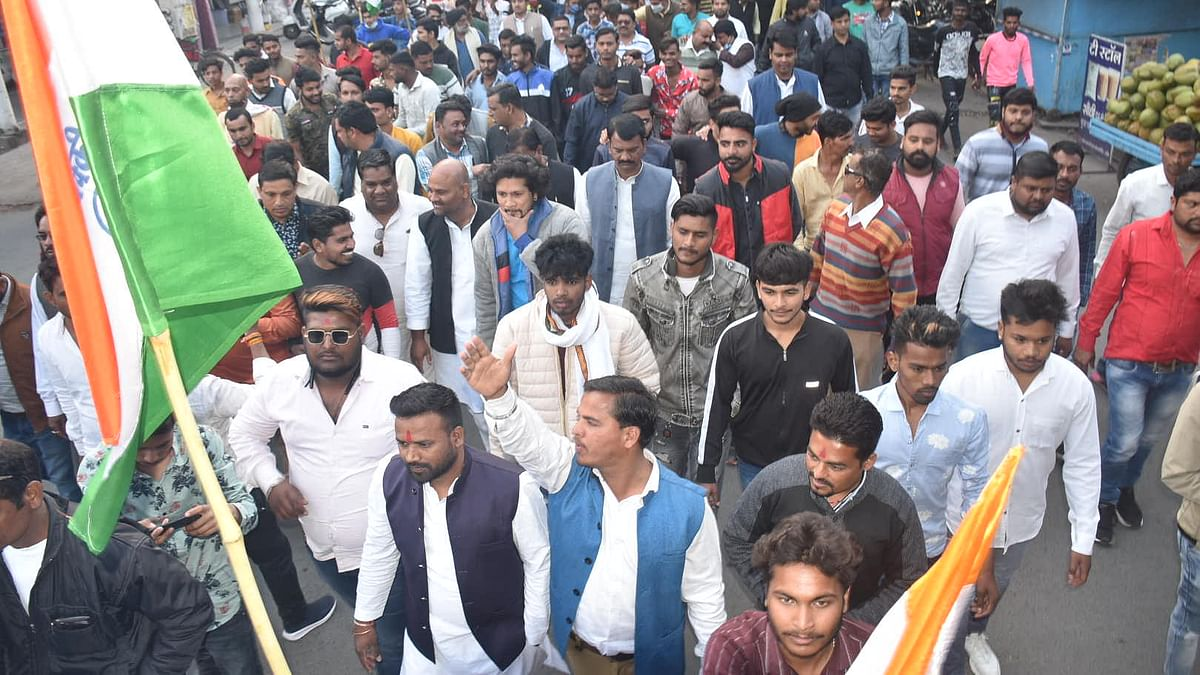 Congress workers raise slogans against hike in fuel price in Ujjain on Friday