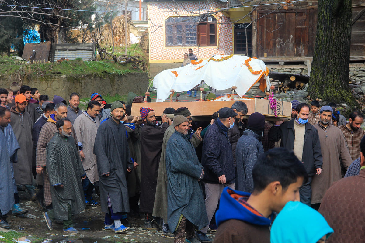 Local Muslims help perform last rites of centenarian Kashmiri Pandit woman in Kunzer village of Jammu and Kashmir.