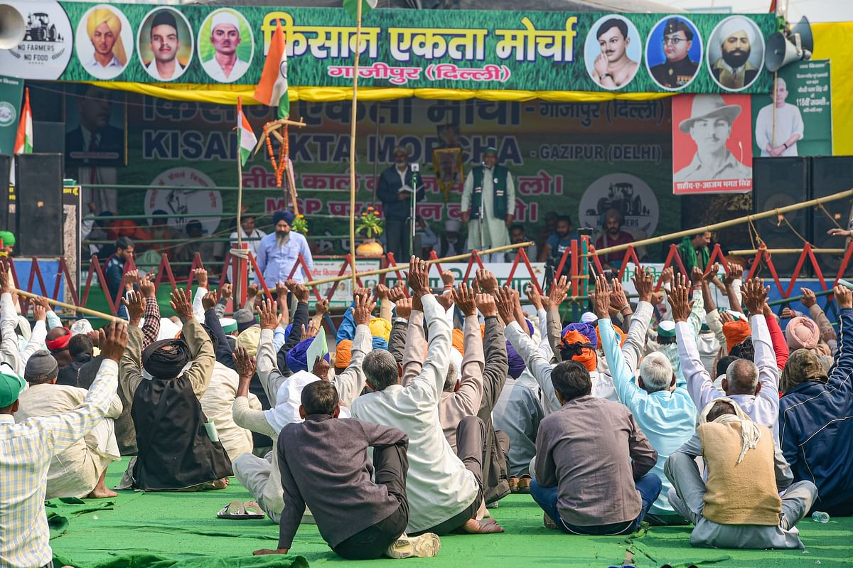 Farmers raise slogans at Ghazipur border during their ongoing protest against Centre's farm reform laws, in New Delhi, on Feb 11, 2021.