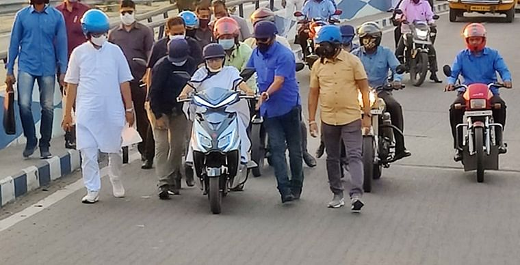 Mamata Banerjee had nearly fallen while driving an electric scooter, however, she quickly regained her balance with the support of the security personnel and continued the ride.