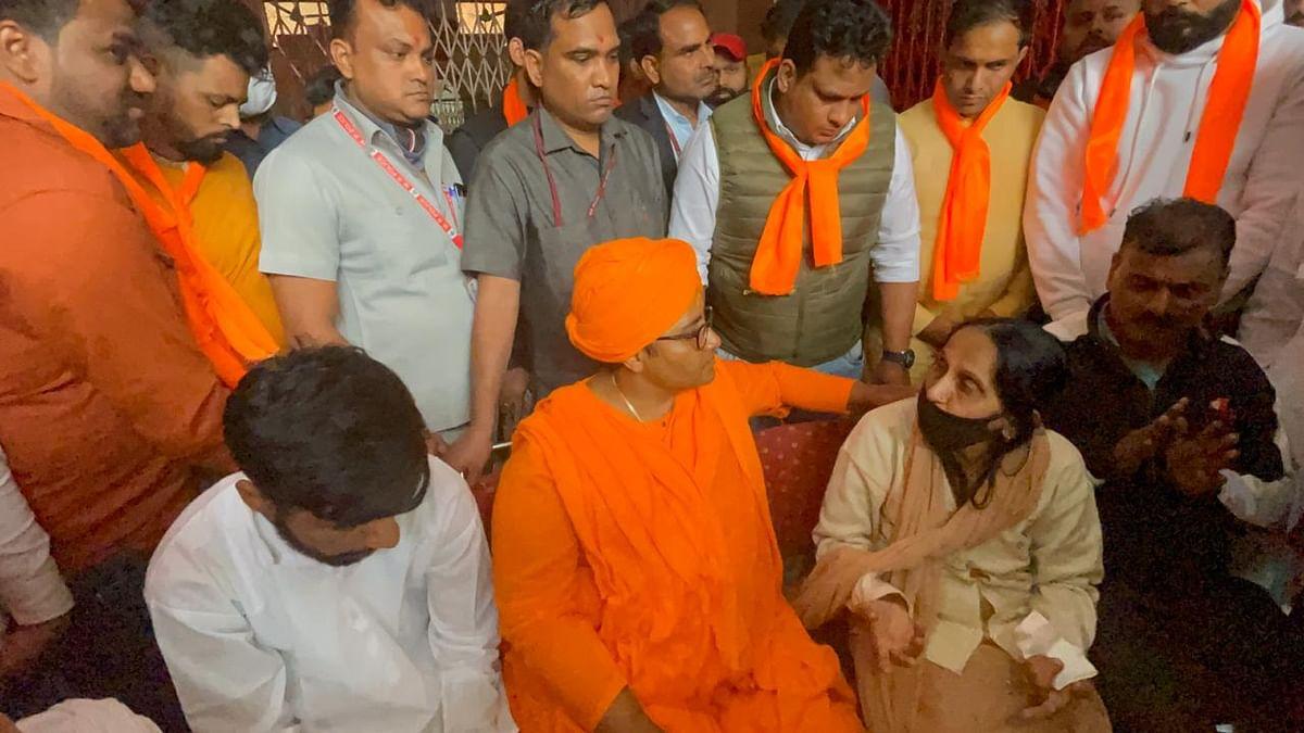 MP Pragya Thakur visits the family of Rinku Sharma in Delhi, on Tuesday.