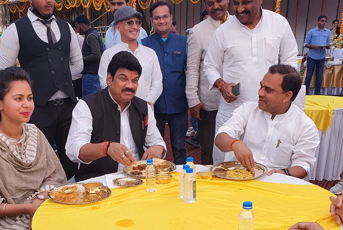 ROME WAS BURNING, NERO WAS PLAYING FLUTE:  Transport Minister Govind Rajput enjoys lunch hoisted by cooperative minister when dozens of passengers were killed after bus plunges in Bansagar canal, Sidhi district on Tuesday.