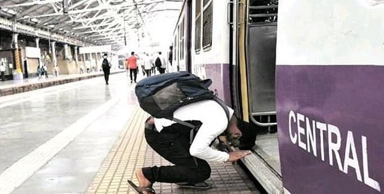 Photo of man bowing down before Mumbai local train goes viral