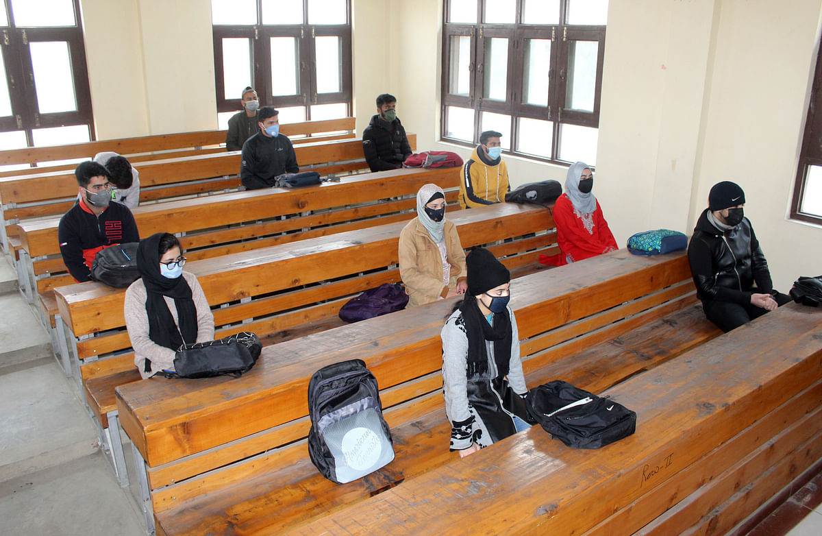 Students wearing face masks as a precaution against the coronavirus, attend classes as Colleges reopen after being closed for months due to the COVID-19 pandemic in Srinagar, Kashmir