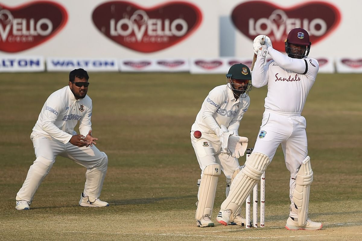 West Indies Kyle Mayers (R) looks plays a shot during the fifth day of the first cricket Test match between Bangladesh and West Indies at the Zohur Ahmed Chowdhury Stadium in Chittagong on February 7, 2021.
