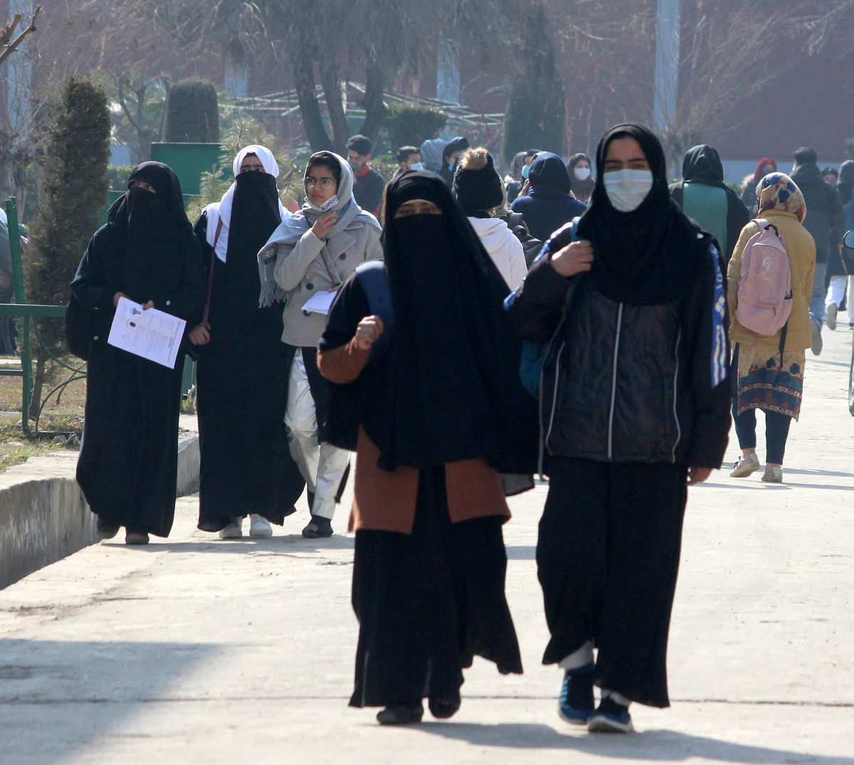 Students arrive at a Government college as the Colleges reopened after almost 11 months of break due to the Covid-19 coronavirus pandemic in Srinagar, Kashmir on February 15, 2021.