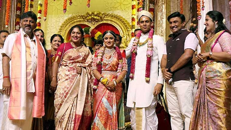 State Congress chief DK Sivakumar with daughter Aishwarya and son in law Amartya Hegde gets clicked during the marriage ceremony held at a private hotel, in Bengaluru on Sunday