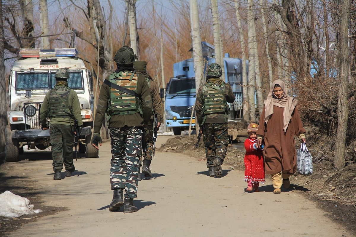 Paramilitary troops are seen near the site of an attack by suspected militants in Barzula Area of Srinagar.