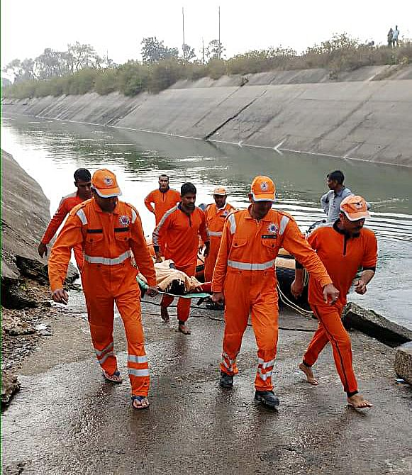 NDRF team carries out rescue operations after an bus plunged into a canal in Sidhi district, Madhya Pradesh on Tuesday.