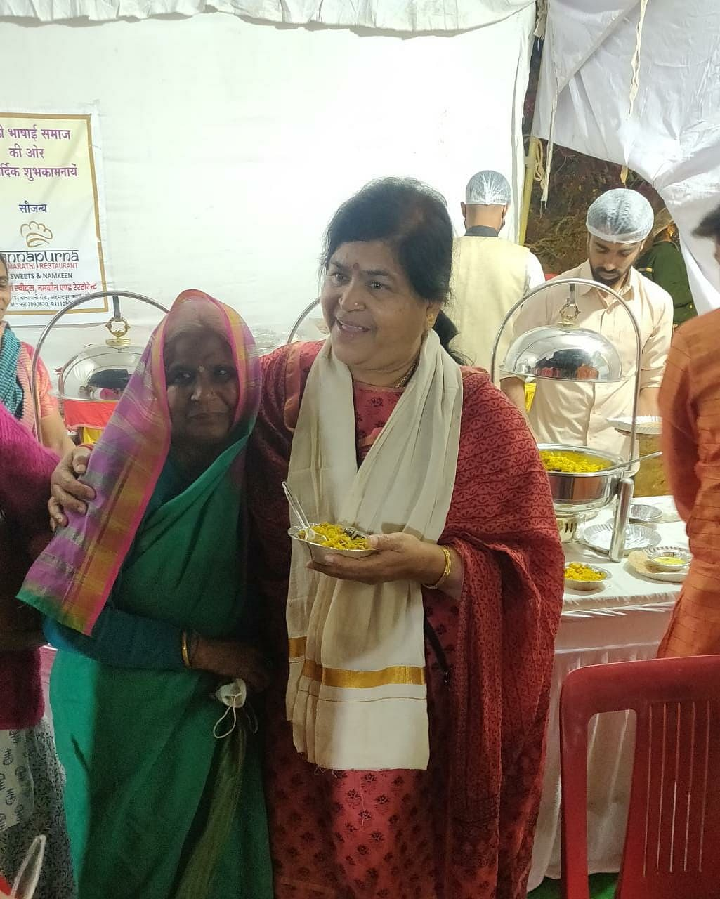 State culture minister Usha Thakur with a woman at food stall