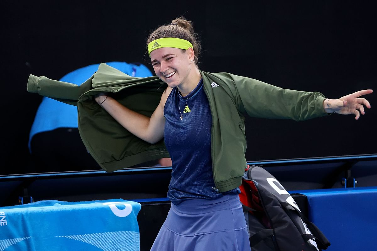 Czech Republic's Karolina Muchova celebrates beating Belgium's Elise Mertens during their women's singles match on day eight of the Australian Open tennis tournament in Melbourne on Monday