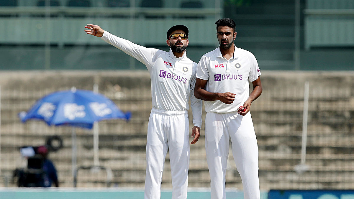 Virat Kohli talks to R Ashwin during the second day's play of the India-England Test in Chennai on Saturday