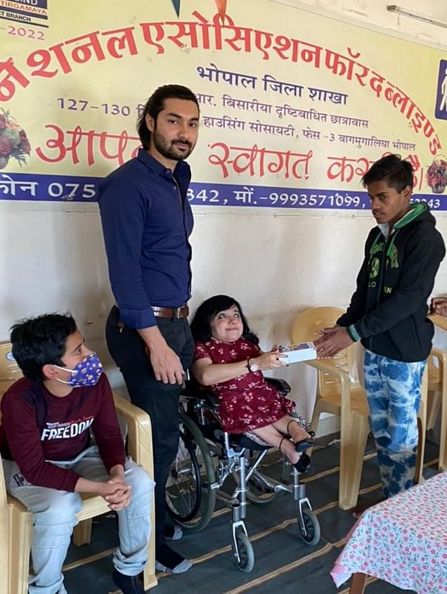Visually impaired boy receiving smart phone