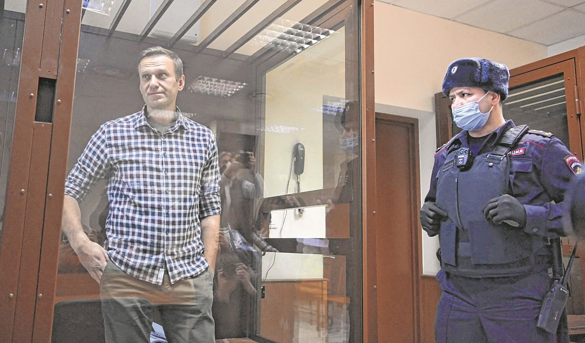 Russian opposition leader Alexei Navalny stands inside a glass cell during a court hearing at the Babushkinsky district court in Moscow on February 20, 2021.