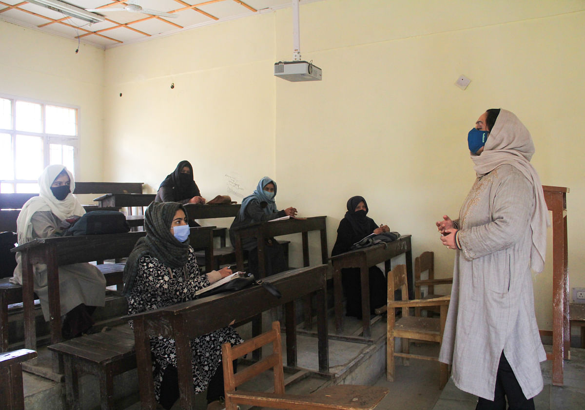 A teacher takes a class at a College that was reopened after remaining shut since March 19, 2020 due to coronavirus pandemic, in Srinagar, Kashmir.