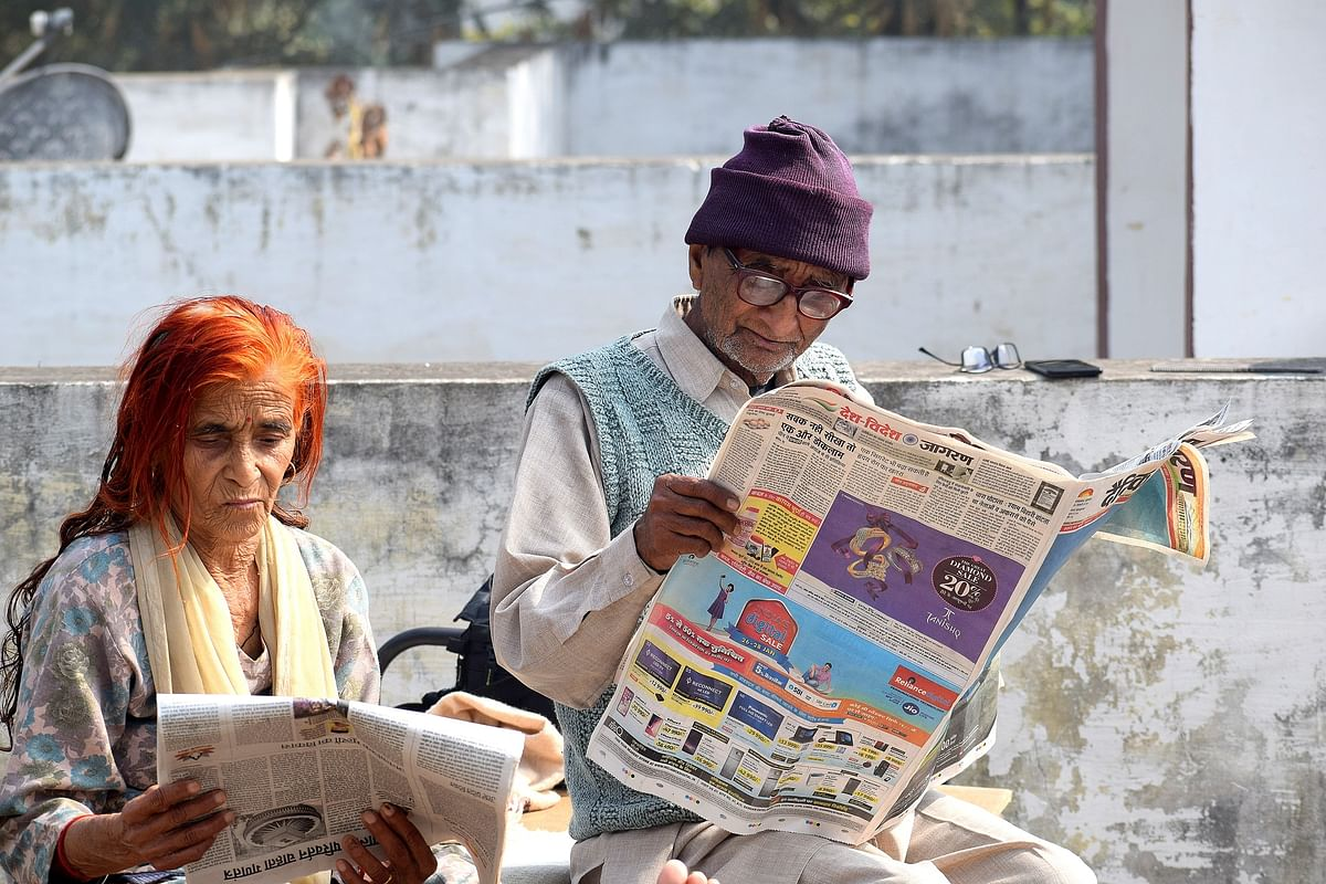 Couple reading Newspaper/file